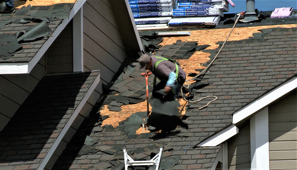 Roof repair and replacement by First General Services.