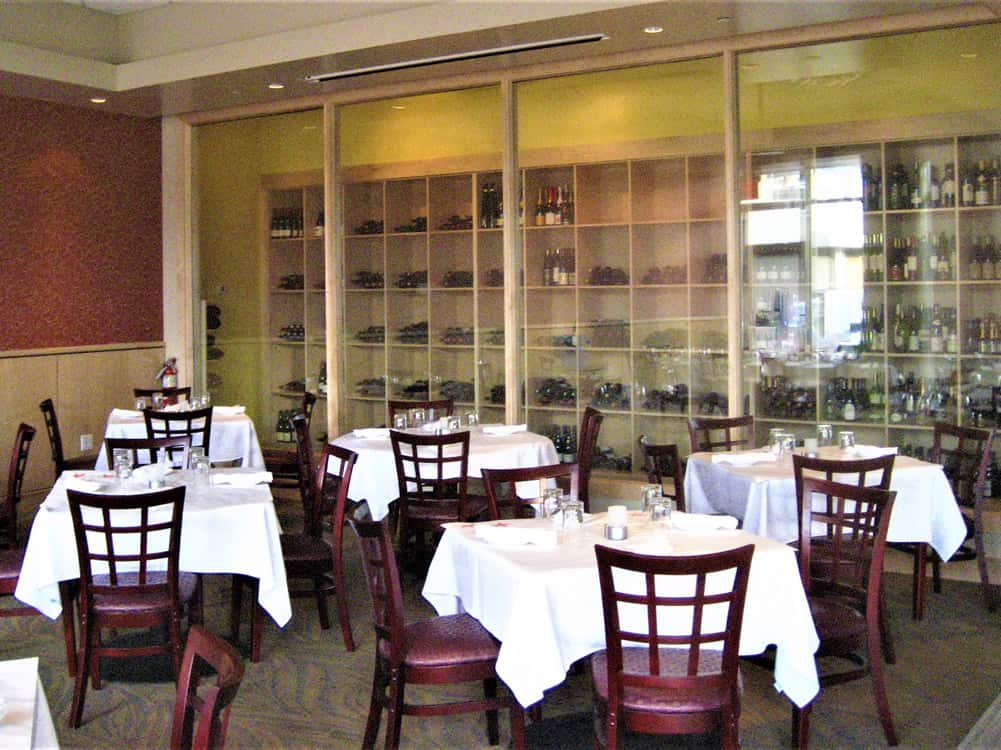 FGS Commercial Build-Out of Sirenuse restaurant in Denver, Colorado - dining area and wine cabinet after